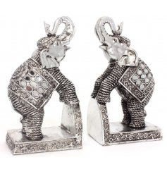 Add an exotic touch to your home displays with this rustic inspired resin elephants