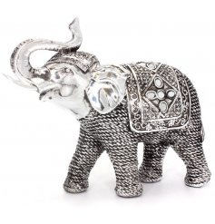 Bring the wild themes of the african plains into your home with this beautifully patterned resin elephant