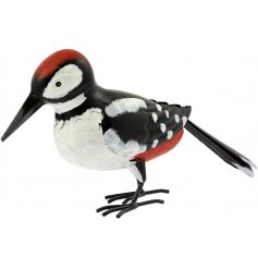 A quirky little perched woodpecker garden figure