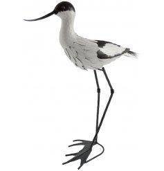 A hand painted pied avocet bird garden ornament
