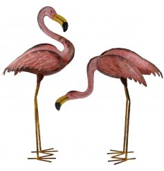 An assortment of 2 hand painted metal flamingo garden ornaments