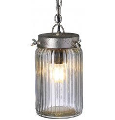A glass jar lamp light on an iron chain