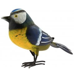 A small blue tit metal garden decoration