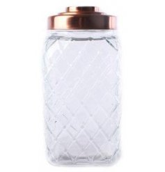A square glass jar with diamond cut and copper lid