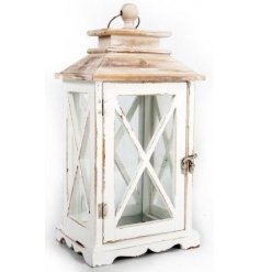 A small white washed wooden candle lantern