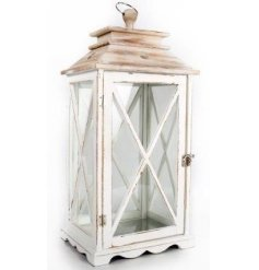 A white washed wood candle lantern