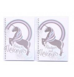 An assortment of 2 A5 pink unicorn notebooks