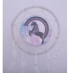 A magical hanging dream catcher with a pretty purple unicorn design to it