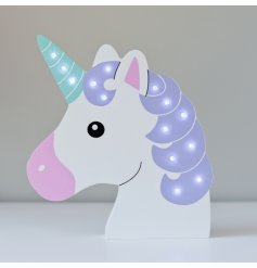 A wooden unicorn head with LED lights on the horn and main