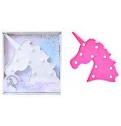A light up LED decoration in the shape of a pink/white unicorn head