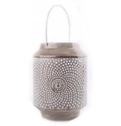 A grey metal lantern with handle