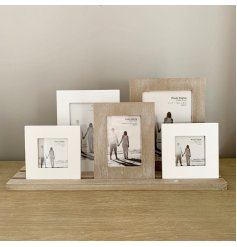 A beautifully distressed set of clustered wooden frames,