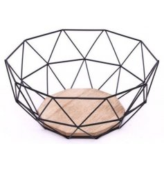 A black geometric wire bowl with wooden base