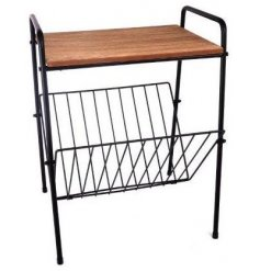 A black wire and wooden magazine rack