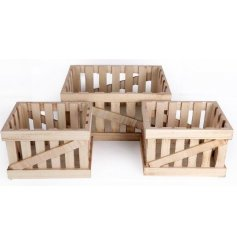 A set of 3 wooden storage crates
