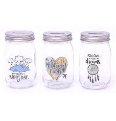 An assortment of 3 Rainy Day/Travel/Dreams Money Jars