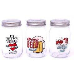An assortment of 3 glass money jars