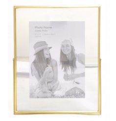 A large gold mirrored photo frame