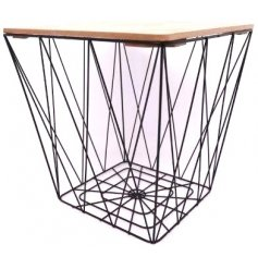 A small side table with square wood top and geometric black wire base