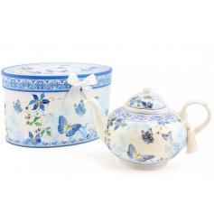 A beautifully decorated Fine China teapot, complete with a sweet spring garden look