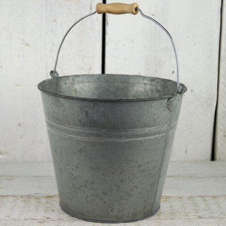 A grey zinc bucket planter
