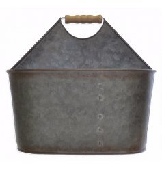 An oval metal carrier with wooden handle