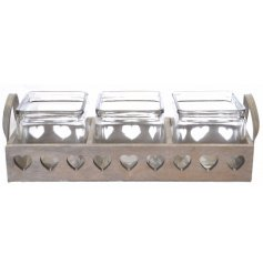A grey wooden tray with 3 glass pots