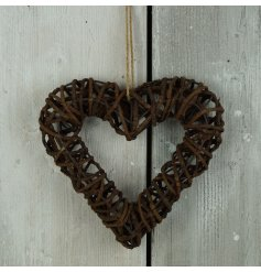A 26cm natural tone rattan heart hanging wreath