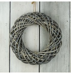This stylish and simple woven wicker wreath will add a perfect rustic charm to any space