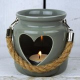 A grey porcelain lantern with cut out heart & rope handle