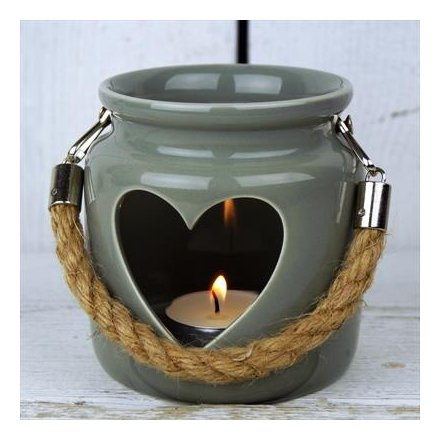 A greeny-grey porcelain lantern with cut out heart & rope handle