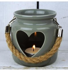A greeny-grey porcelain tealight lantern with cut out heart