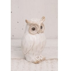 Add a beautifully rustic feel to any home space with this carving styled owl