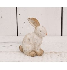 Add a beautifully rustic feel to any home space with this carving styled rabbit