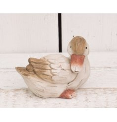 Add a beautifully rustic feel to any home space with this carving styled duck