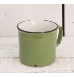 Add a distressed farmers vibe to any kitchen space with this green toned ceramic mug