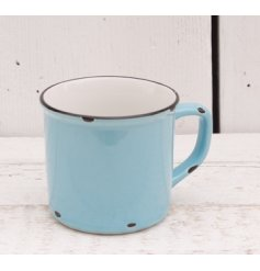 Add a distressed farmers vibe to any kitchen space with this blue toned ceramic mug