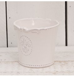 A beautifully smooth glaze finished ceramic pot, complete with a embossed Fleur De Lis