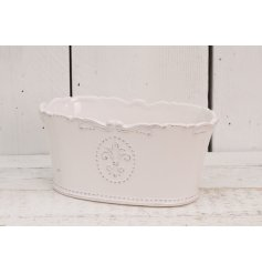 A beautifully smooth glaze finished ceramic trough, complete with a embossed Fleur De Lis