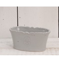 A beautifully smooth glaze finished ceramic trough, complete with an embossed Fleur De Lis