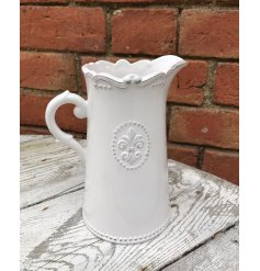 A beautifully smooth glaze finished ceramic jug, complete with a embossed Fleur De Lis