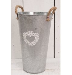 Add this beautifully distressed zinc vase into any home or garden space for a chic rustic feel