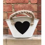 A chic cream planter with chunky rope handles and a blackboard heart in the centre for labelling