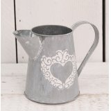 Add this beautifully distressed zinc jug into any home or garden space for a chic rustic feel