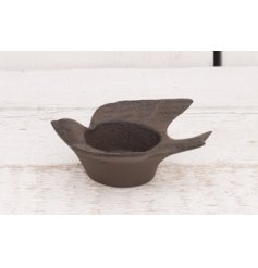 Add this beautifully simple cast iron tlight holder to any home or garden for a distressed chic feel