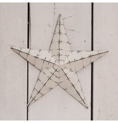 A medium sized Rough Luxe barn star featuring an off white tone and subtly distressed finish