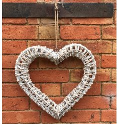 This white woven willow heart wreath will make a simple, romantic statement in any home all year round.