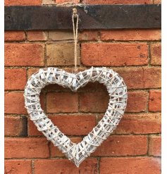 A medium size white willow heart hanging decoration