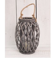 A large grey woven lantern with rope handle