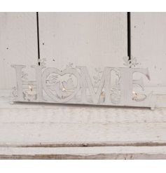 A charming little candle holder featuring a white washed tone and HOME text